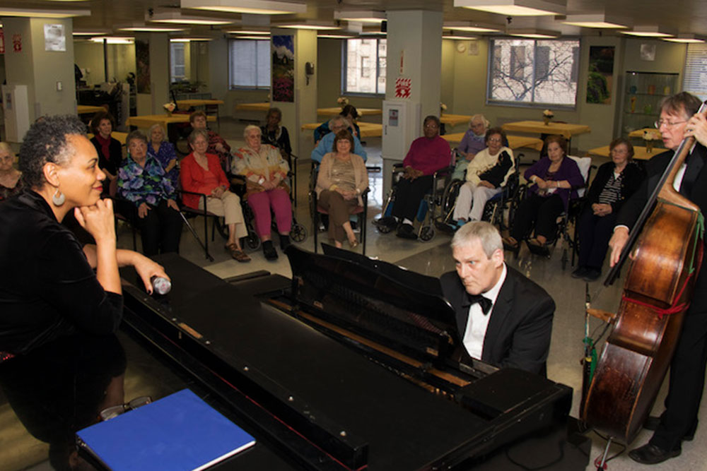 Classical musicians performing for long term residents.